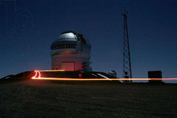 Mauna Kea Observatory - Telescope Gemini north - Mauna Kea Observatory - Telescope Gemini north - Mauna Kea Observatory, 4200 metres, altitude, Hawaii, USA. In the foreground, the lights of a car