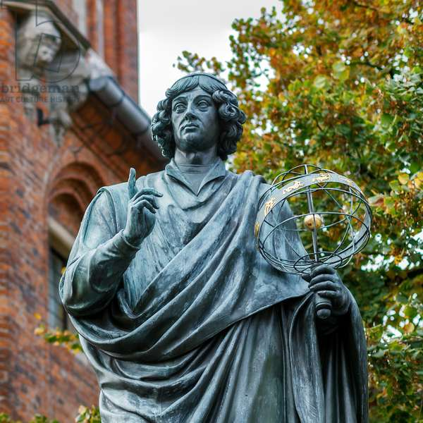 Torun, Poland, October 19, 2013: Monument erige in 1853 paying homage to Nicolas Copernicus (1473-1543), Polish canon and astronomer - The Nicolaus Copernicus Monument in Torun, the home town of astronomer Nicolaus Copernicus (1473-1543). The statue was erected in 1853
