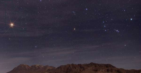 Orion and Mars Constellation - Constellation of Orion with Mars - Orion Constellation, with on its left the brilliant planet Mars, above the Taftan volcano, Iran. Stars of Orion, with the bright planet Mars on its left, above Taftan volcano. Iran - Pakistan border
