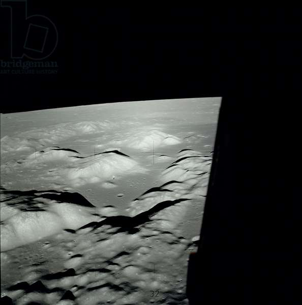 Moon: Landing site of Apollo 17 - Region of Taurus - Littrow; landing site is visible at the top right of the image; Image obtained during the Apollo 17 mission, from the LEM on 10 December 1972 before landing. To the center of the image we distinguish the control module