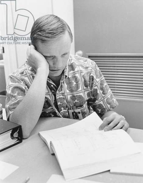 Apollo 11: N.Armstrong - Neil A. Armstrong checks his flight plans during the final preparations. 14/07/1969. Neil A. Armstrong reviews flight plans during final preparations. Jul 14 1969