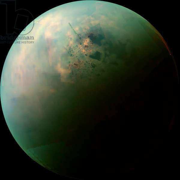 """Titan, Saturn satellite seen by Cassini: Visible and infrared composite image of Titan taken by the Cassini probe on September 12, 2013. View of methane and ethane lakes. - This false-color mosaic, made from infrared data collected by Nasa's Cassini spacecraft, reveals the differences in the composition of surface materials around hydrocarbon lakes at Titan, Saturn's largest moon. Titan is the only other place in the solar system that we know has stable liquid on its surface, though its lakes are made of liquid ethane and methane rather than liquid water. While there is one large lake and a few smaller ones near Titan's south pole, almost all of Titan's lakes appear near the moon's north pole - Scientists mapped near-infrared colors onto the visible color spectrum. Red in this image was assigned a wavelength of 5 microns (10 times longer than visible light), green 2.0 microns (four times longer than visible light), and blue 1.3 microns (2.6 times longer than visible light) - The orange areas are thought to be evaporite - the Titan equivalent of salt flats on Earth. The evaporated material is thought to be organic chemicals originally from Titan's haze particles that once dissolved in liquid methane. They appear orange in this image against the greenish backdrop of Titan's typical bedrock of water ice - In this mosaic, Kraken Mare, which is Titan's largest sea and covers about the same area as Earth's Caspian Sea and Lake Superior combined, can be seen spreading out with many tendrils on the upper right,. The big dark zone up and left of Kraken is Ligeia Mare, the second largest sea. Below Ligeia, shaped similar to a sports fan's foam finger that points just up from left, is Punga Mare, the third largest Titan Sea. Numerous other smaller lakes dot the area. Titan's north pole is located in the geographic location just above the end of the """""""" finger"""""""" of Punga Mare. The data shown here were obtained by Cassini's visual and infrared mapping spectrometer during"""