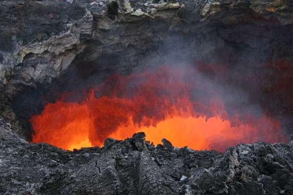 Lava tunnel on the Puu Oo -Kilauea -Hawaii - Puu Oo lava tube -Kilauea -Hawaii - Lava tunnel on the Puu Oo, an event of the Kilauea Shield volcano in Hawaii. Lava tube in Puu Oo crater, an active cone on the shield volcano Kilauea, in Hawaii