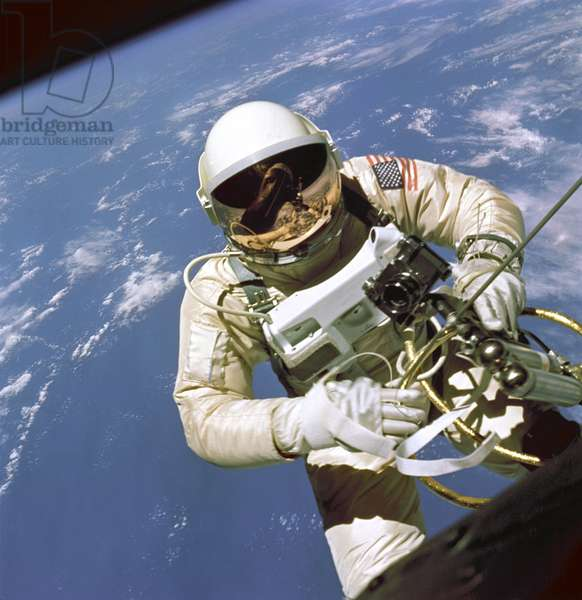 Gemini 4: release of Ed.White - Gemini 4: Ed White EVA - First release of an American into space made by Edward White on June 3, 1965. On June 3, 1965 Edward H. White II became the first American to step outside his spacecraft and let go, effectively setting himself adrift in the zero gravity of space. For 23 minutes White floated and maneuvered himself around the Gemini spacecraft while logging 6500 miles during his orbital walk. White was attached to the spacecraft by a 25 foot umbilical line and a 23 - ft. tether line, both wrapped in gold tape to form one cord. In his right hand White carries a Hand Held Self Maneuvering Unit (HHSMU) which is used to move about the weightless environment of space. The visor of his helmet is gold plated to protect him from the unfiltered rays of the sun