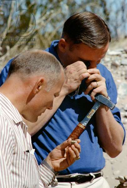 """Armstrong and Aldrin 02/1969 - E.Aldrin and N.Armstrong in geological trip - Buzz Aldrin (a g.) and Neil Armstrong in geology training (rock samples). 24/02/1969. Buzz Aldrin (left) and Neil Armstrong examines rock samples in west Texas near Sierra Blanca and the ruins of Fort Quitman, about 130 kilometers southeast of El Paso. They went into the large arroyos to learn how to sample when a variety of rocks are spread out."""""""" 24 February 196"""