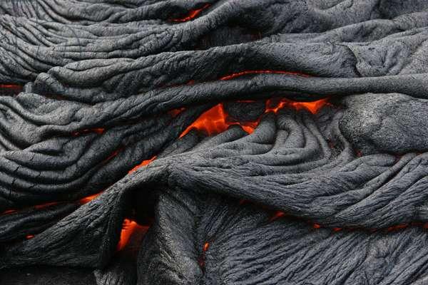 Lava flow on the volcano Kilauea -Hawaii - Lava flow on Kilauea volcano -Hawaii - Cooling of a lava flow Pahoehoe, a type of basaltic lava fluid characteristic of the volcano Shield Kilauea a Hawaii. Cooling Pahoehoe (fluid and smooth basaltic lava) flow on the shield volcano Kilauea, in Hawaii