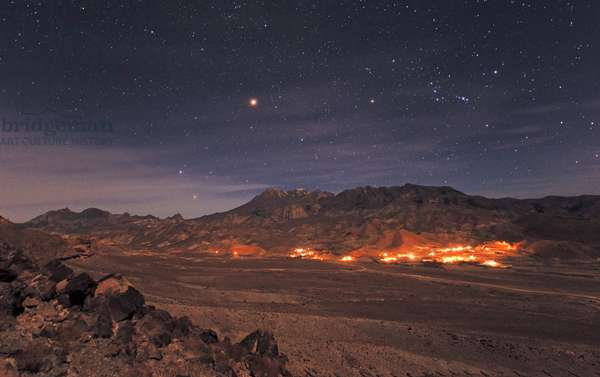 Khash, Sistan & Baluchestan, Iran, December 16, 2007: Orion Constellation, with its left the brilliant planet Mars, in opposition, above the Taftan volcano, Iran. December 2007 - The red planet Mars at it's brightest (opposition) and winters stars appear over Mt. Taftan, a 4000 meter volcano in the southeastern Iran