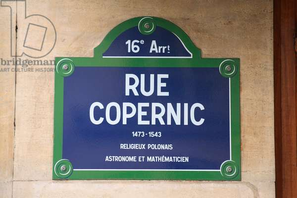 "Plaque de la rue Copernic in Paris - Street Plaque in Paris - Rue du 16eme arrondissement de Paris, in tribute to Nicolas Copernic (1473 - 1543), Polish canon and astronomer. He became famous by publishing the year of his death ""De la revolution des orbes celestial"", a book in which he defends the idea of a heliocentric system. In this system the planets, including the Earth, revolve around the Sun. The heliocentric system was confirmed by Galilee observations in 1609. Street Copernic, street sign. Polish astronomer Nicolaus Copernicus is the author of De revolutionibus orbium coelestium where he introduced the heliocentric theory and displaced the Earth from the center of the Universe"