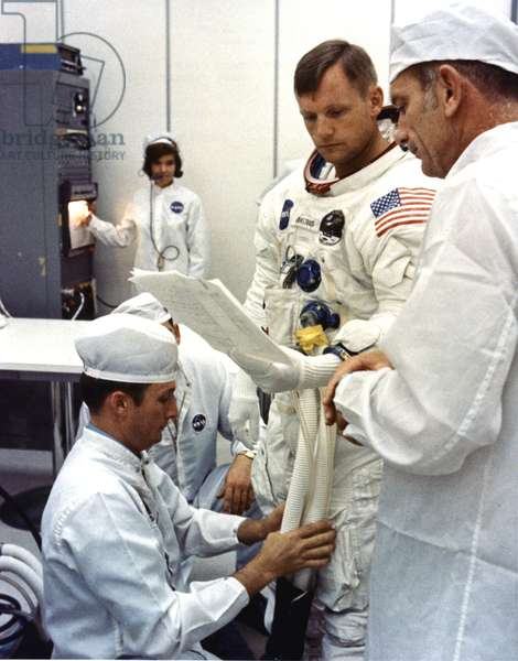 Apollo 11: Neil Armstrong - Neil Armstrong during suitup. Jul 16 1969 - Dressing for Neil Armstrong before departure, Apollo mission 11. 16/07/1969. Neil Armstrong during suitup. Jul 16 1969