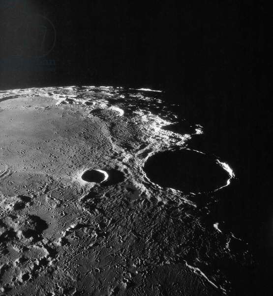 Moon: Theophile crater - Moon: Theophilus crater - View of the large impact crater Theophile with the Madler crater and the Nectar Sea on its left. Image obtained in July 1969 from the command module of Apollo 11. An Apollo 11 oblique view of the large crater Theophilus located at the northwest edge of the Sea of Nectar on the lunar nearside. Theophilus is about 60 statute miles in diameter. The smooth area is Mare Nectaris. The smaller crater Madler, about 14 statute miles in diameter, is located to the east of Theophilus. Visible in the background are the large crater Fracastorius and the smaller crater Beaumont. The coordinates of the center of this photograph are 29 degrees east longitude and 11 degrees south latitude