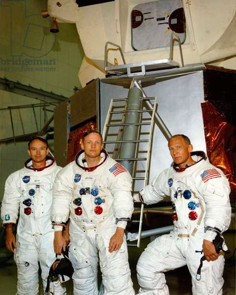 Crew of the Apollo 11 lunar landing mission - Mike Collins, Neil Armstrong and Edwin Aldrin pose in front of the LEM model. 19/06/1969. Mike Collins, Neil Armstrong, and Edwin Aldrin pose in front of a mockup lunar module. Jun 19 1969