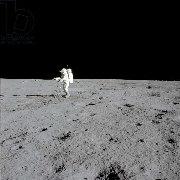 Apollo 14: E. Mitchell on the Moon - Apollo 14: E. Mitchell moonwalk - Edgar Mitchell realises a panoramic view with a television camera. 05/02/1971. Lunar Module Pilot Edgar Mitchell performs a panoramic view with the television camer