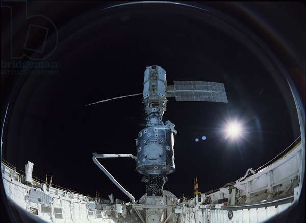 ISS: Unity and Zarya modules. 12/1998 - ISS: Unity and Zarya modules. 12/1998 - Astronaut James Newman completes the last connections on Unity. 15/12/1998. The crew of Space Shuttle Mission STS - 88 began construction of the International Space Station, joining the U.S. - built Unity node to the Russian - built Zarya module. The crew carried a large - format IMAXA (R) camera from which this picture was taken. Astronaut James Newman making final connections to Unity. December 1998