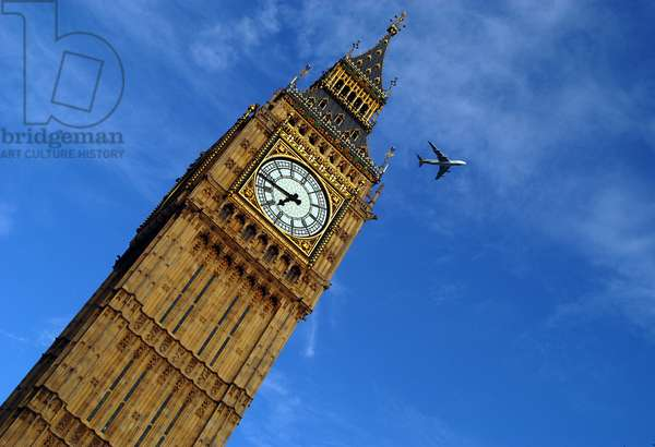 London: Big Ben and plane - London: Big Ben and airplane - A passenger airplane passes over the clock tower of Westminster Palace in London. A plane is flying above the clock tower of the palace of Westminster in London