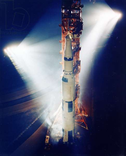 Apollo 13: Saturn V on his shooting pitch - Apollo 13: Saturn V on launch pad at night - Fusee Saturn V/Apollo 13 on his shooting pitch. Apollo 13 (Spacecraft 109/Lunar Module 7/Saturn 508) space vehicle spotlit on the launch pad. The Apollo 13 launch has been scheduled for 2:13 p.m. (EST), April 11, 1970