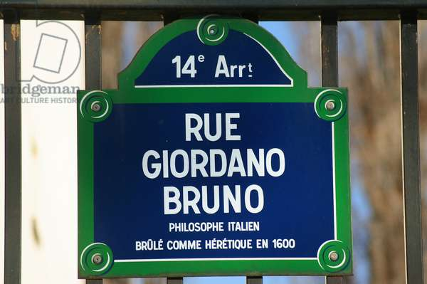 Plaque de la rue Giordano Bruno a Paris - Street Plaque in Paris - Rue du XIVth arrondissement de Paris, in tribute to Giordano Bruno (1548 - 1600), Dominican monk, philosopher, victim of the Inquisition. On the basis of Copernicus's work, he shows in a philosophical way the relevance of an infinite universe, people of a countless number of worlds identical to ours. Accused of heresie, book at the Inquisition and torture, he was sentenced to death and burnt alive in Rome on 16 February 1600. Giordano Bruno Street, street sign. Giordano Bruno (1548 - 1600) was an Italian Dominican friar, philosopher, mathematician and astronomer, who was found guilty of heresy and burnt by the Inquisition because of his works about the infinity of the universe