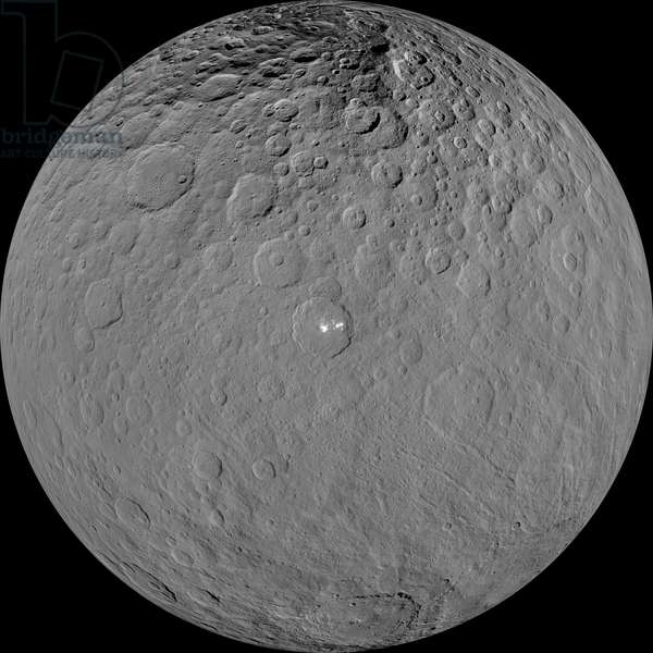 The Dwarf Planet Ceres seen by the Dawn probe - Dwarf Planet Ceres: Image reconstructed in very high resolution from observations made by the Dawn probe, showing the dwarf planet Ceres with the occator crater in the center. This orthographic projection shows dwarf planet Ceres as seen by Nasa's Dawn spacecraft. The projection is centered on Occator Crater, home to the brightest area on Ceres. Occator is centered at 20 degrees north latitude, 239 degrees east longitude. This image was made from views Dawn took during its low-altitude mapping orbit, at about 240 miles (385 kilometers) above the surface. The image resolution is about 120 feet (35 meters) per pixel