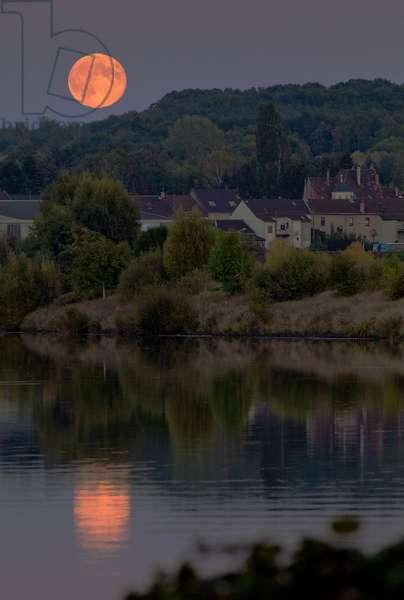 Sunrise - Harvest Moon rises - The Full Moon of early October, the Harvest Moon, rises above Saar river in Saarland, Germany