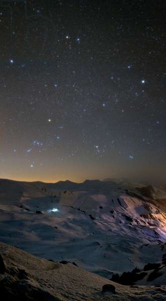Winter Constellations - Winter Constellations - Winter sky with the constellation Orion (lower left), Little Dog (above left) with bright star Procyon, Gemels (top), Coach (right) and Bull (right of Orion). Elbourz Mountains, Iran. March 27, 2009. Constellations of Orion, Canis Minor, Gemini, Auriga and Taurus above snowy mountains of Alborz in Iran. March 27, 2009