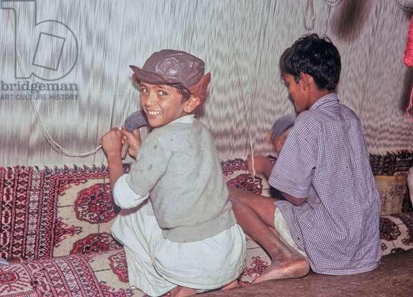 Child labour; Carpet weaving, Carpet factory, Karachi, Pakistan, 1969 (photo)
