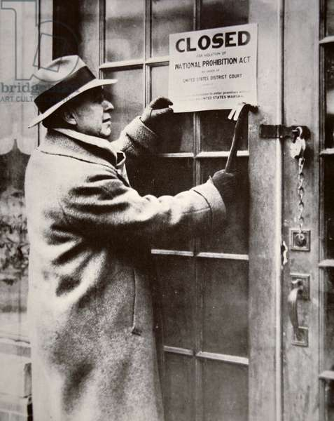 A US Federal Agent closing a saloon during the American Prohibition (1920-33) (b/w photo)