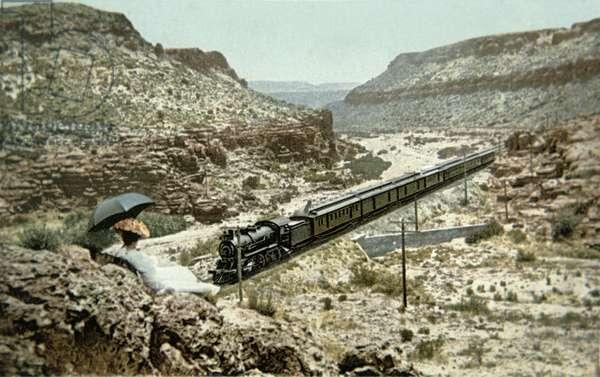 Postcard of a train of the Santa Fe Railroad passing through Crozier Canyon, Arizona (colour litho)
