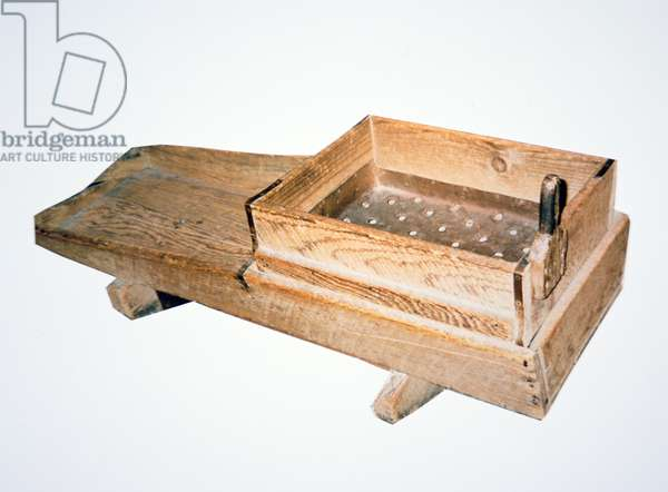 A prospector's 'rocker' used for separating gold from river silt (wood)