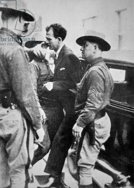 Jack 'Legs' Diamond (1896-1931) being taken into police custody, 1918 (b/w photo)