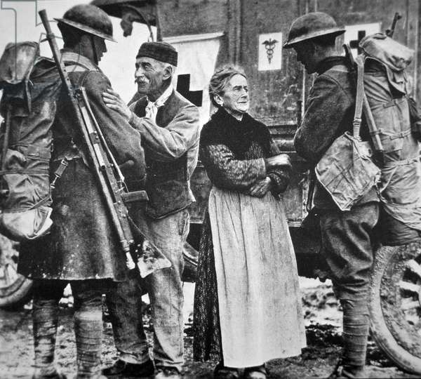 French peasants greet two heavily-laden Americans, 1917 (b/w photo)