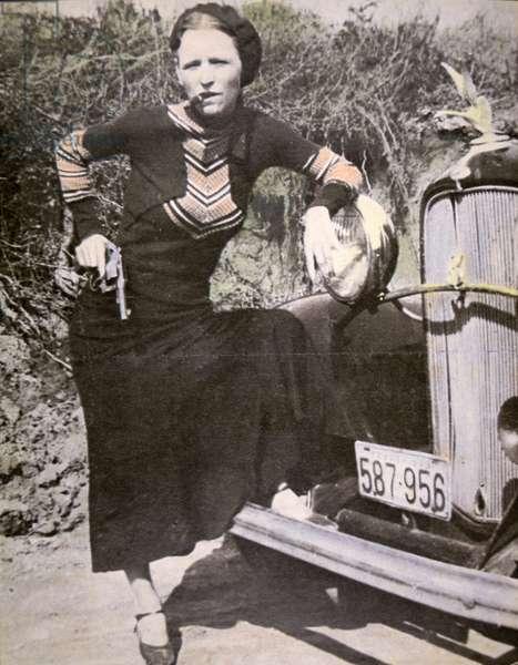 Bonnie Parker posing 'tough' with a gun and cigar, c.1934 (b/w photo)