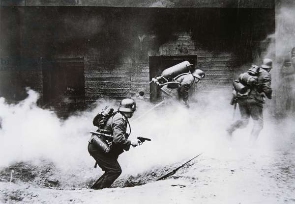 Stormtroops armed with a flamethrower attack a French blockhouse, France, 1940 (b/w photo)