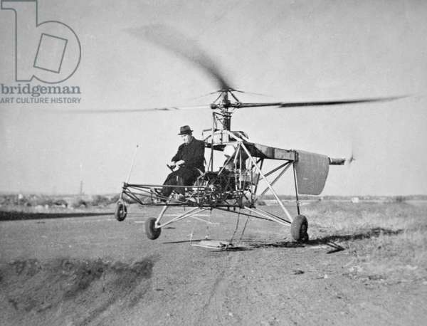 Igor Sikorsky at the controls of the VS-300 helicopter he designed on its first flight, 1939 (b/w photo)