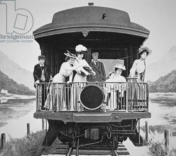 Tourists taking scenic photographs from the rear observation platform of a Union Pacific train, 1910 (b/w photo)