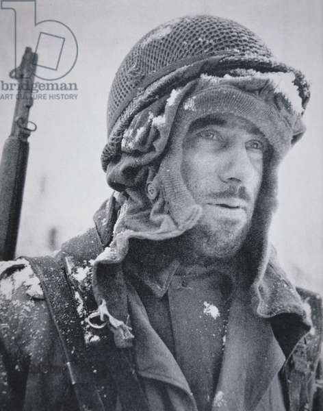 American GI wrapped up against the bitter cold, Belgium, December 1944 (b/w photo)