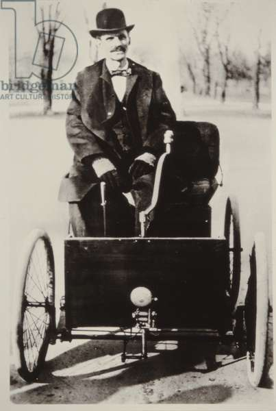 Henry Ford in his first Ford motorcar, 1896 (b/w photo)