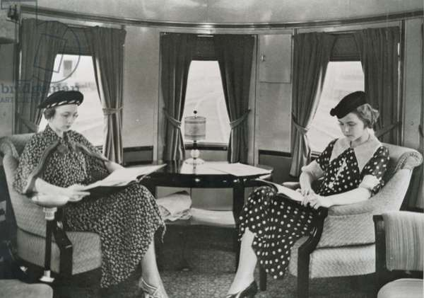 Women reading in the rear lounge car of the 'Royal Blue' train of the Baltimore & Ohio railroad, 1936 (b/w photo)