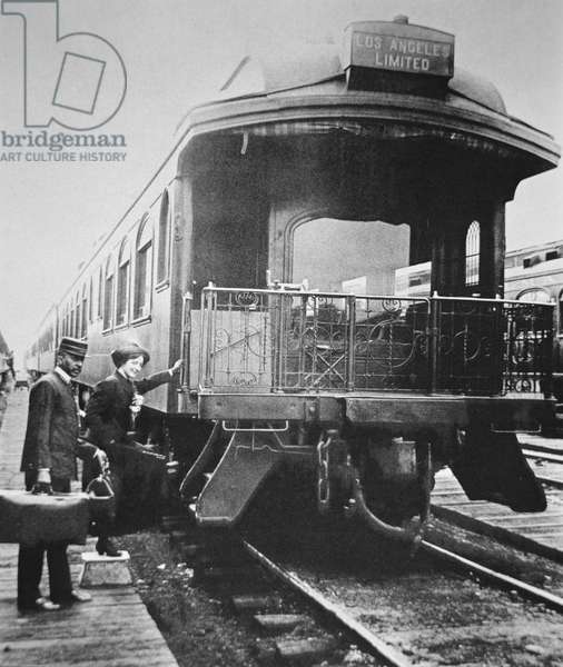 A passenger boarding the Los Angeles Limited train of the Union Pacific Railroad in 1910 (b/w photo)