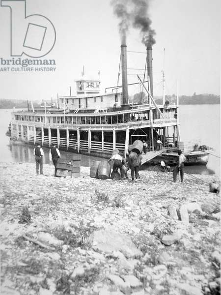 Loading a stern-wheeler on the Ohio River, c.1900 (b/w photo)