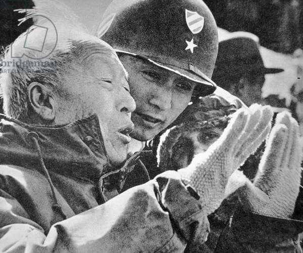 President Syngman Rhee of South Korea watching army manoeuvres with Brigadier-General Oh, 1952 (b/w photo)