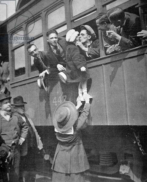 US Army recruits bid farewell to family before the train journey to training camp, 1917 (b/w photo)