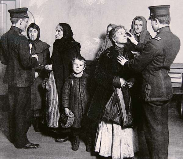 Newly arrived immigrants undergoing medical examination on Ellis Island, New York, c.1910 (b/w photo)