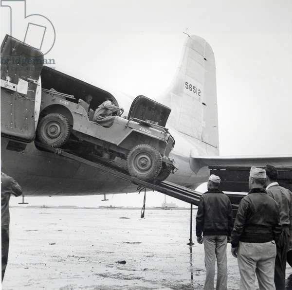 Unloading a jeep from Douglas 'Skymaster' at Shanghai airport, China, during the Second World War (b/w photo)