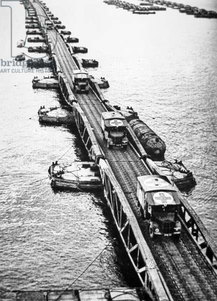 Ambulances of the Allied landing forces using a Mulberry Pier of the Mulberry artificial harbour that had been towed across the channel, 6th June 1944 (b/w photo)