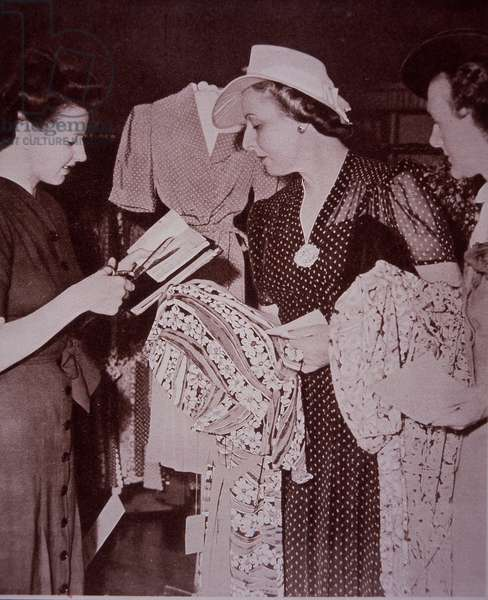 Women buying clothes with ration clothing coupons, 1940-49 (b/w photo)