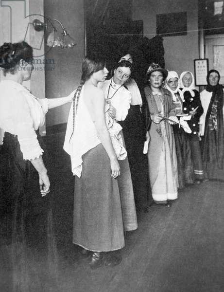 European women undergo medical examination on Ellis Island, New York, c.1900 (b/w photo)