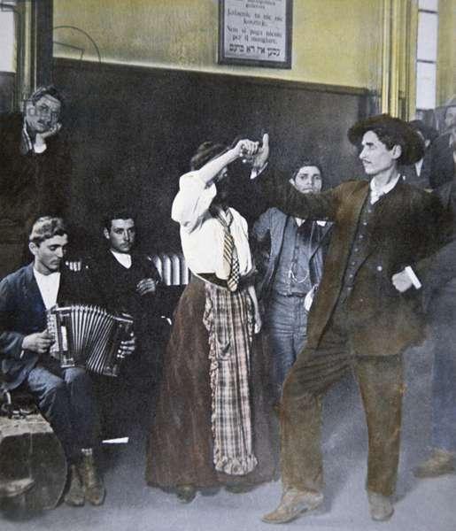 Immigrants folk dancing on Ellis Island, New York, 1907 (colour litho)
