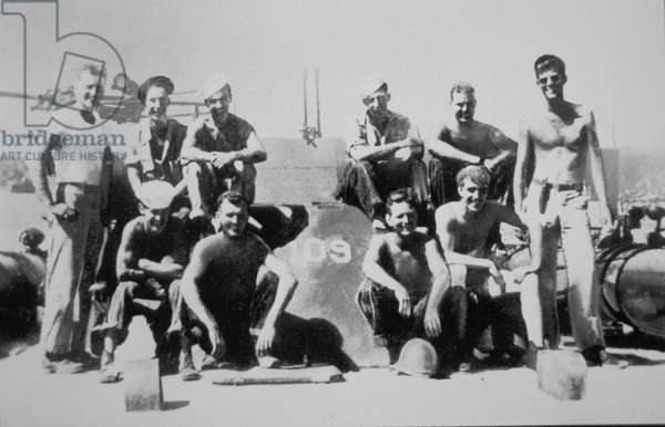 Lieutenant John F. Kennedy with the crew of his patrol torpedo boat PT-109, July 1943 (b/w photo)