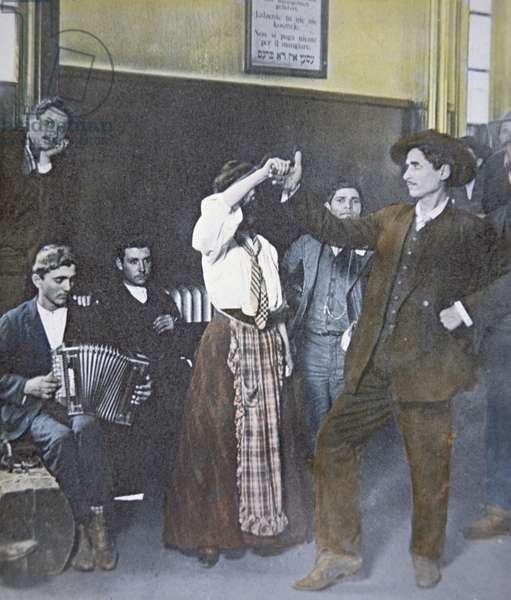 Immigrants in folk dance on Ellis Island, New York Harbor, 1907 (b/w photo)