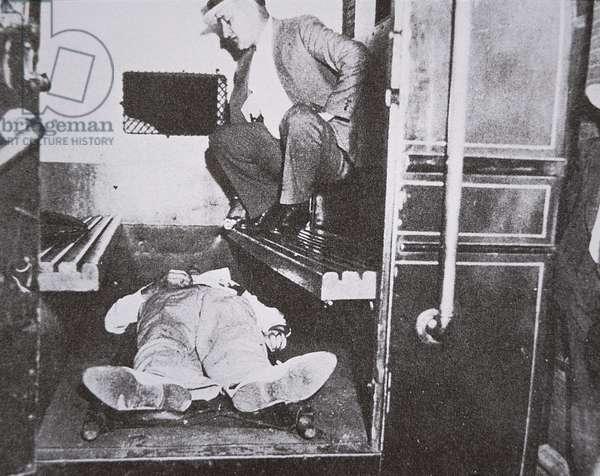 John Dillinger dead in a police wagon, 22nd July 1934 (b/w photo)