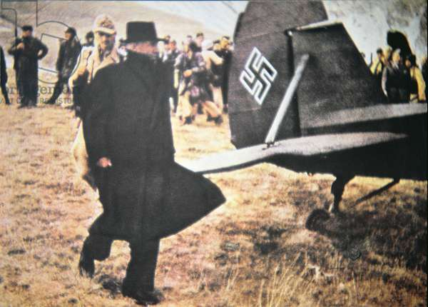 Benito Mussolini walks to a German light aircraft after his recue by commandos led by Otto Skorensky from a mountain stronghold, 12th September 1943 (photo)